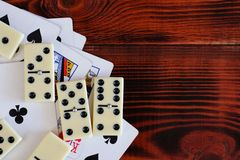 Various board games chess board, playing cards, dominoes. Hobby. Metaphor for games and gambling Stock Photography