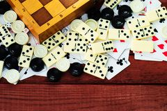 Various board games chess board, playing cards, dominoes. Royalty Free Stock Photography
