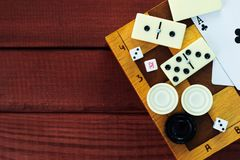 Various board games chess board, playing cards, dominoes. Royalty Free Stock Photos