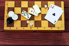 Various board games chess board, playing cards, dominoes. Royalty Free Stock Image