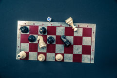 Various board games and figurines over checkers board Royalty Free Stock Photos