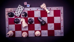 Various board games and figurines over checkers board stock video footage
