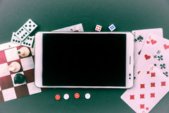 Various board games with tablet pc. Royalty Free Stock Photos