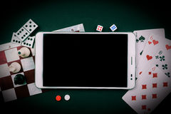 Various board games with tablet pc. Royalty Free Stock Image