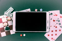 Various board games with tablet pc. Stock Photos