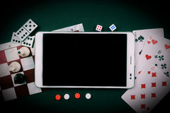 Various board games with tablet pc. Royalty Free Stock Photo