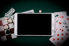 Various board games with tablet pc. Stock Photography