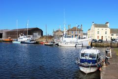 Various boats in Glasson Dock basin, Lancashire. View of several different types and sizes of boats moored in the lower basin at Glasson Dock near Lancaster Royalty Free Stock Photos
