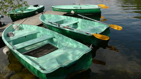 Various boats on  lake water and reflections stock footage