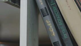 Various books on the bookshelf stock video footage