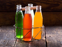Various bottles of fruit juice. On wooden table Stock Photo