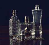 Various bottles of woman perfume Stock Image