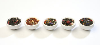 Various Bowls Of Premium Tea Leaves Blends Stock Photos