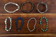Various bracelets over wooden background Stock Photography