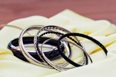 Various bracelets on a yellow fabric Royalty Free Stock Photography