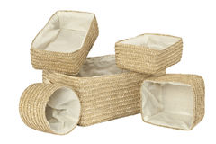 Various braided bamboo baskets on white Stock Photo
