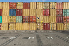 Various brands and colors of shipping containers Stock Image