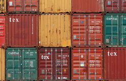 Various brands and colors of shipping containers Stock Photography