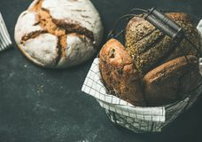 Various bread loaves over black background, copy space Stock Photos
