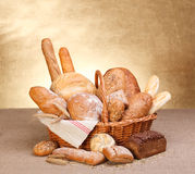 Various breads. In basket on canvas tablecloth Royalty Free Stock Images
