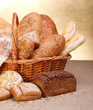 Various breads. In basket on canvas tablecloth Royalty Free Stock Photo