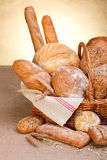Various breads. In basket on canvas tablecloth Royalty Free Stock Photos