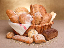 Various breads. In basket on canvas tablecloth Stock Photo