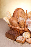 Various breads. In basket on canvas tablecloth Stock Image