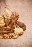 Various breads in basket Stock Photos
