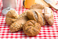 Various breads on checkered tablecloth Stock Image