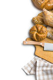 Various breads with cutting board and knife Royalty Free Stock Image