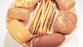 Various breads. Over white background stock footage