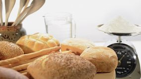 Various breads. Rotating on white background stock footage