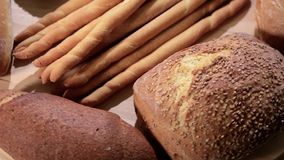 Various breads. Rotating on wood stock video