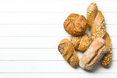 Various breads. Top view of various breads on white wooden background Royalty Free Stock Image