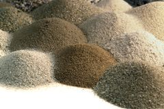 Various brown toned sand piles together Royalty Free Stock Photos