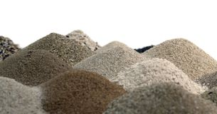 Various brown toned sand piles together Royalty Free Stock Image