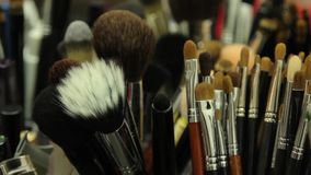 Various brushes of make-up artist, close up. Various and different brushes of make-up artist, close up stock video