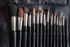 Various brushes for makeup is the row Royalty Free Stock Images