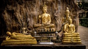 Free Various Buddha Statues In The Temple Of Thailand. Buddha Sits, Buddha Lies. Wooden Background. Royalty Free Stock Images - 110864959