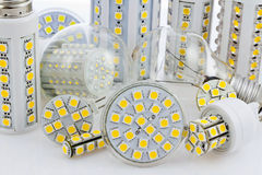 Various bulbs with 3-chip SMD LEDs. Next to tungsten bulb Stock Photos