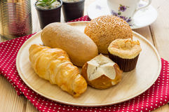 Various bun and bread on wood table Royalty Free Stock Images