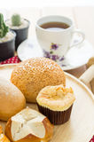 Various bun and bread on wood table Royalty Free Stock Photos