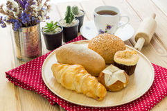 Various bun and bread on wood table Royalty Free Stock Photo