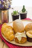 Various bun and bread on wood table Stock Image