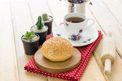 Various bun and bread on wood table Stock Photo