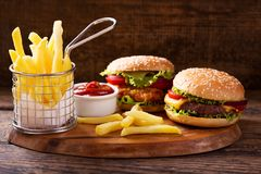 Various burgers with french fries stock photo