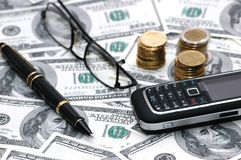 Various business objects. Over hundred dollar bills Stock Photo