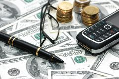 Various business objects. Over hundred dollar bills Royalty Free Stock Photography