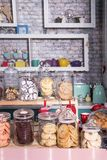 Various cakes and biscuits in a cafe on the counter. Showcase with sweets. Various cakes and biscuits in a cafe on the counter Royalty Free Stock Images